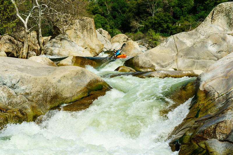 Darin Mcquoid drops into one of the bigger rapids of the Middle Tule.