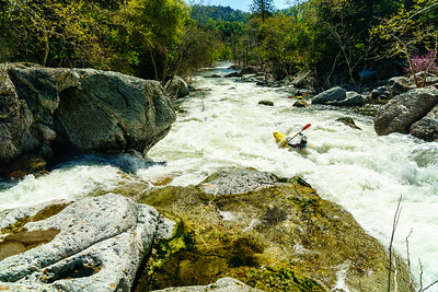 Daphnee Tuzlak crashing through one of the later rapids on the North Fork of the Kaweah near Sequoia National Park.