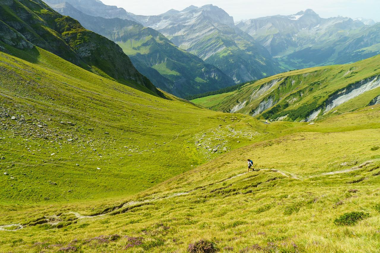 Daphnee Tuzlak begins the descent towards Elm from Foo Pass, Switzerland.