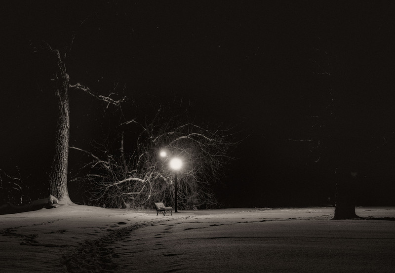 A vacant park bench, late night, after the snow.  Ketring Park, Littleton, CO.