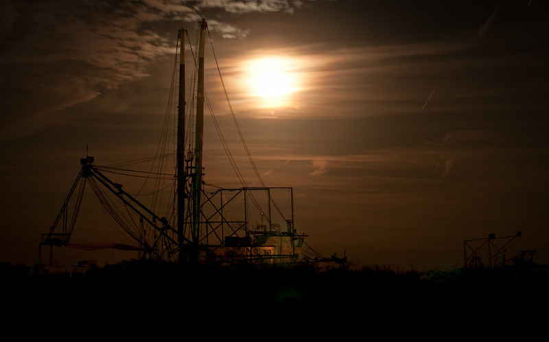 Shrimp boat in the light of the rising moon.  Hackberry, Louisiana.