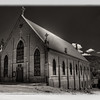 Black and white version of the St. Victor Catholic Church in downtown Victor, Colorado.
