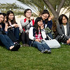 Visitors from South Korea pose for a photo on the grassy knoll.