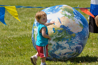 Stock image of small child with an inflated earth ball at the International Kite and Culture Festival in Georgetown Kentucky USA.  This was in celebration of Earth Day.
