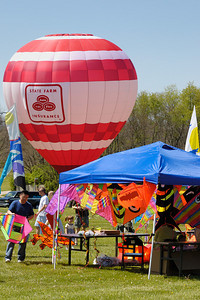 Stock image of kite sales tens and hot air balloon at the International Kite and Culture Festival in Georgetown Kentucky USA