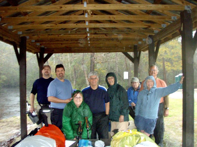 The whole gang at Seven Runs Trailhead, waiting out the rain.  Jeff, Marvin, Bluegill (Chris), Stump (Bill), Igloo (Joan), Fire Ant (Beth), Bumpkin (Terri), and Stan.  Photographer: Cricket (Deb).