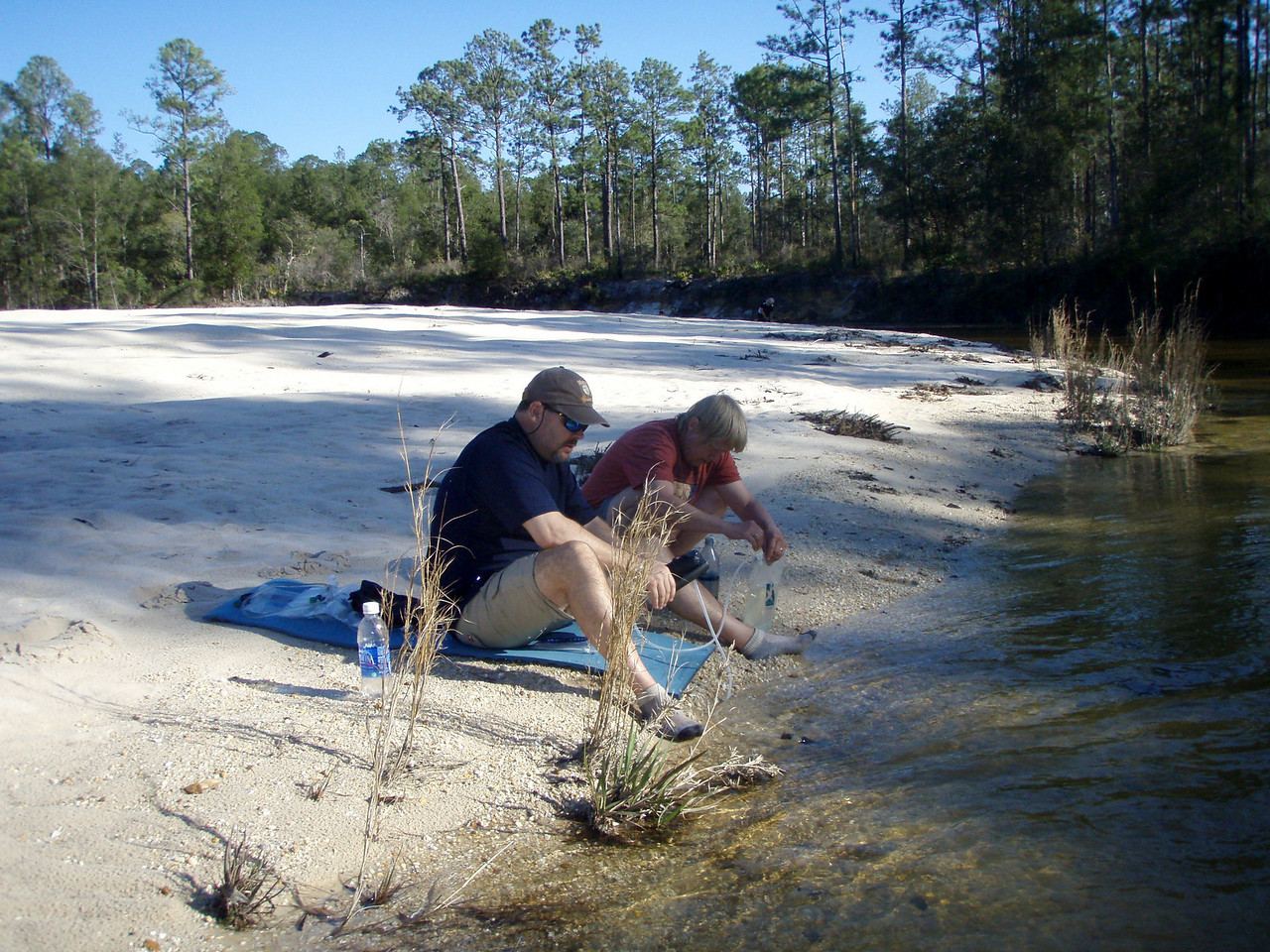 Camp chores at Football Field sandbar on Juniper Creek.
