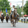 Second Company Governor's Horse Guard Major Gordon Johnson leads members through the Newtown Labor Day Parade. (Bobowick photo)
