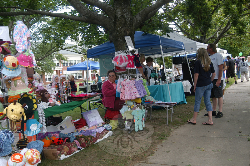 Vendors offered up a variety of goods and foods in front of the middle school on Queen Street for this year's Labor Day Parade. (Hallabeck photo)