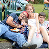 Palmer and Kim Chiappetta watched the Newtown Labor Day Parade from their Main Street home with sons Jonathan, left, and Jackson. (Bobowick photo)