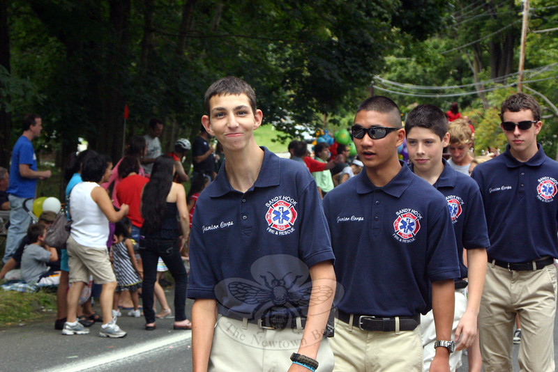 Sandy Hook Volunteer Fire & Rescue Junior Corps Captain Andy DeWolfe, on the left, with Corps members Cal Brock, RJ Oliveira and David Kent.   (Bee Photo, Hicks)