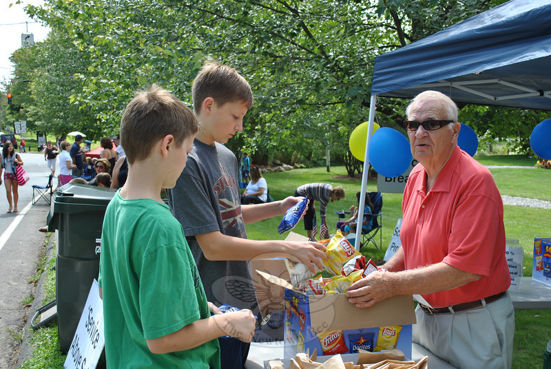Newtown Rotary Club member Lou Holzner sold chips at this year's Newtown Labor Day Parade. (Crevier photo)