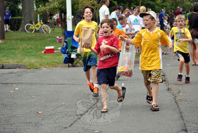 Kids go running for candy thrown from parade participants during the parade. (Crevier photo)