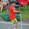 A parade goer rode a scooter down Main Street during this year's Newtown Labor Day Parade. (Crevier photo)
