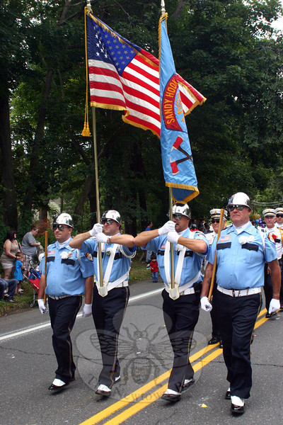 Sandy Hook Volunteer Fire & Rescue's color guard led the company, which appeared in the fourth division and won Best Fire Department this year. From left is John Jeltema, Kevin Stoyak, Bradley Richardson and Steven Stohl.  (Bee Photo, Hicks)