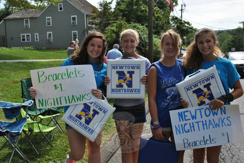 Members of the Newtown High School Girls Softball team sold bracelets and stadium cushions at this year's Newtown Labor Day Parade. From left are Danielle Shine, Katie Mossbarger, Mikayla Kuligowski, and Gillian Galante. (Crevier photo)