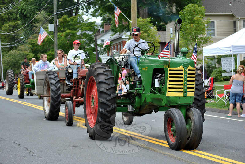 Antique tractors at this year's Newtown Labor Day Parade. (Crevier photo)