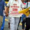 "A mass of marchers from the striking New England Health Workers union momentarily put a damper on the parade. The group's application indicated just four marchers carrying a banner would attend, supporting this year's parade theme ""Caring for Newtown,"" to let people know that despite the strike, health care workers continued to care for their patients. The Parade Committee was as surprised as everyone else to see a group of strikers show up in the middle of the parade.   (Crevier photo)"
