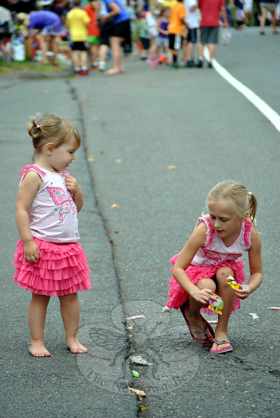 Two girls collecting candy at this year's Newtown Labor Day Parade. (Crevier photo)