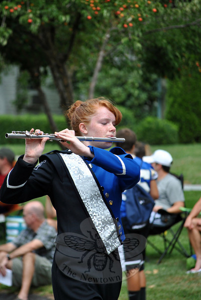 A Newtown High School Marching Band flutist at this year's Newtown Labor Day Parade. (Crevier photo)