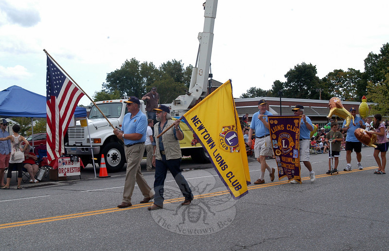 Newtown Lions Club members and supporters walked along Queen Street during the 2012 Newtown Labor Day Parade. (Hallabeck photo)