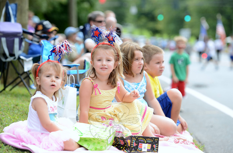 Isabell and Alicia LiGouri wear their sparkling star head bands as they watch the Newtown Labor Day Parade. (Bobowick photo)