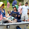 An adorable and adoptable puppy caught a ride on the Newtown Underwater Search & Rescue's float. (Voket photo)