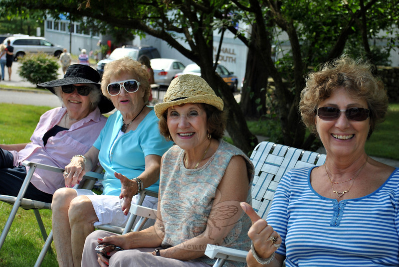 From left are friends Jeanne Mulvihill, Betty Tahan, Marianne Muskus, and Carla Grimardi, seated curbside at this year's Newtown Labor Day Parade. (Crevier photo)