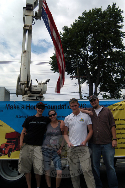 "From left, Charles ""Chalex"" Hawley, Rita Selleck, Michael Cunningham, and Tom Selleck stood in front of a Make A Home Foundation Sign on Queen Street before the 2012 Newtown Labor Day Parade began. (Hallabeck photo)"