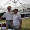 Curtis Beck, orthodontist, and Anita Lucsky handed out balloons at Dr Beck's booth on Queen Street for the 2012 Newtown Labor Day Parade. (Hallabeck photo)
