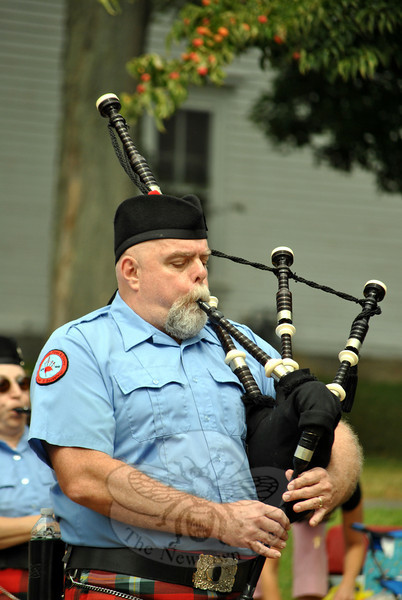 A piper with the Litchfield Hills Pipe Band at this year's Newtown Labor Day Parade. (Crevier photo)