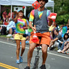 A juggler on a unicycle at this year's Newtown Labor Day Parade, part of the group representing Newtown Juggling & Circus Arts Club. (Crevier photo)