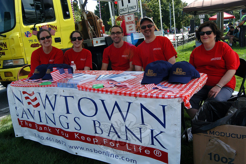 Newtown Savings Bank was represented by a booth on Queen Street during the 2012 Newtown Labor Day Parade. (Hallabeck photo)