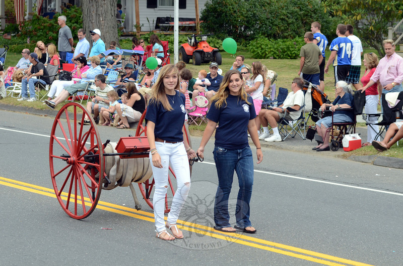 Volunteers from Newtown Hook & Ladder showed off one of two vintage firefighting pieces the company owns in the 2012 Labor Day parade. (Voket photo)
