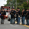 Members of The 11th Connecticut Volunteer Infantry Company A at the Newtown Labor Day Parade, ready to fire their charges. (Crevier photo)