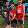 2012 Newtown Labor Day Parade goers, from left, Jennifer, Eric and Aidan Downey waited along Queen Street for the parade to begin. (Hallabeck photo)