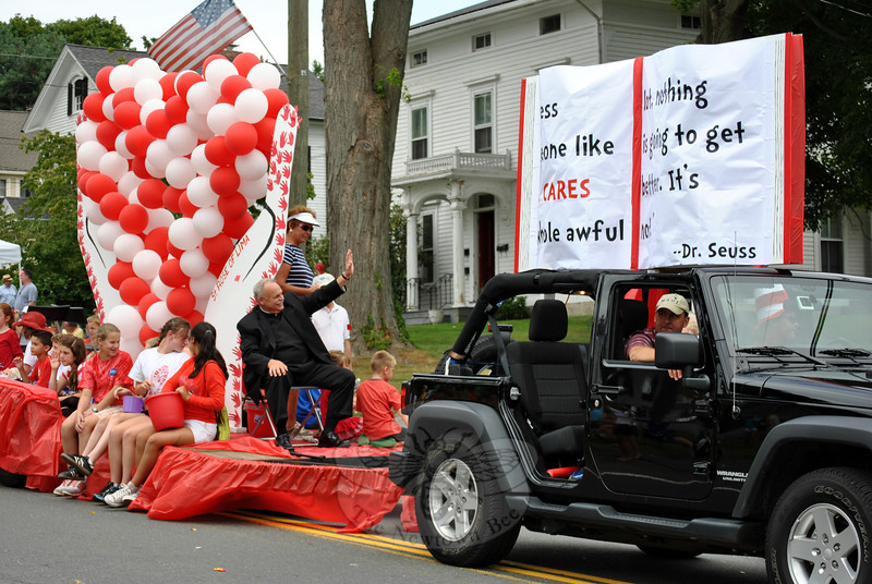 Monsignor Robert Weiss gives a wave from The St Rose of Lima float at this year's Newtown Labor Day Parade. St Rose School received  (Crevier photo)