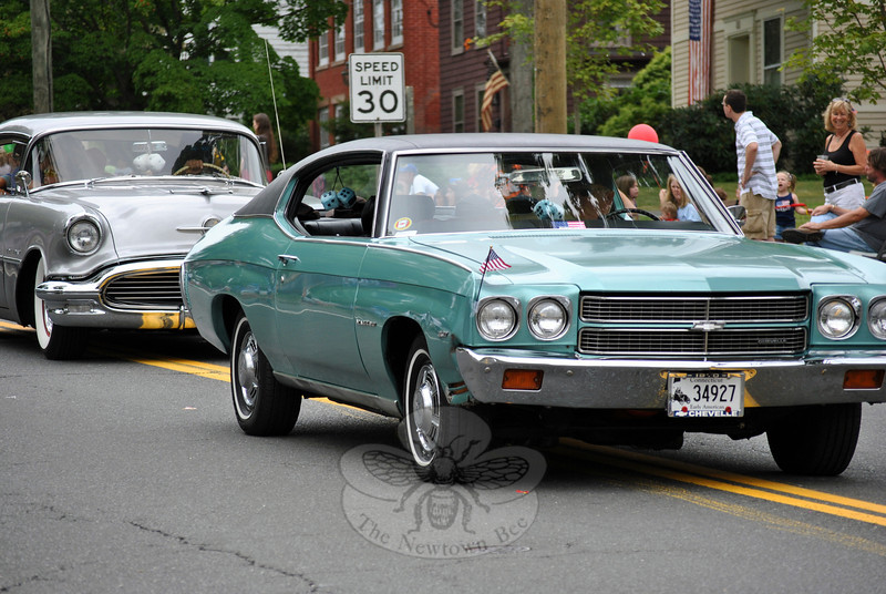 Cars run along the parade route at this year's Newtown Labor Day Parade. (Crevier photo)