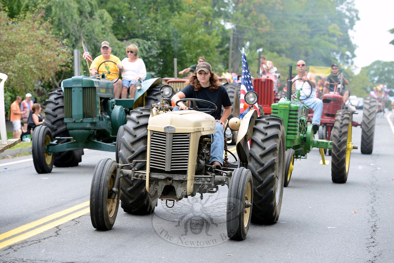 Tractors traditionally signal the end of Newtown's annual Labor Day Parade, and this year was no different. (Bobowick photo)
