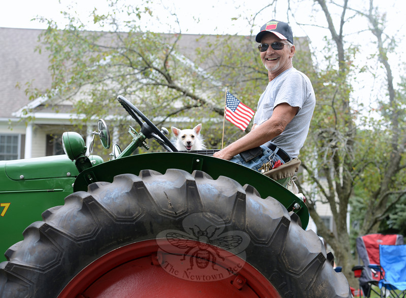 George Birch rides his tractor with his little dog Casey beside him at this year's Newtown Labor Day Parade. (Bobowick photo)