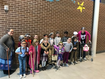 Voss Farms students and staff celebrate the 100th day of school by dressing up as 100 year olds
