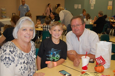 Lane White and his Grandfriends enjoy lunch at Memorial Elementary on November 15.