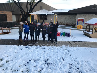 Lone Star Early Childhood Center staff enjoys playing in the snow on Friday, December 9, 2017.