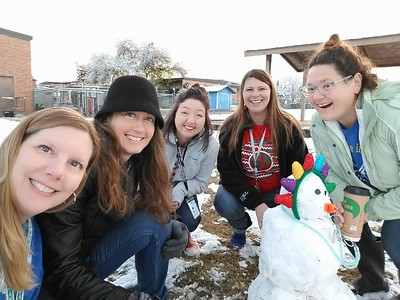 Lone Star Early Childhood Center teachers build a snowman on Friday, December 8, 2017.