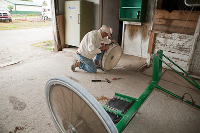 This photo was selected too!  John Knifely working on a sulky wheel at the Coles County Fairgrounds.