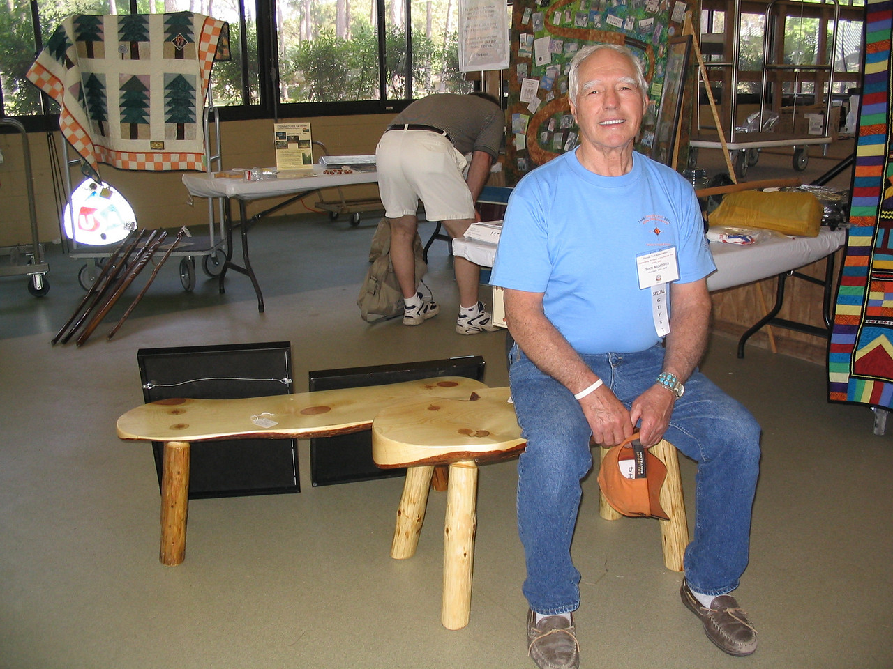 Tom Montoya and one of his beautiful slab benches<br /> PHOTO CREDIT: Diane Wilkins / Florida Trail Association