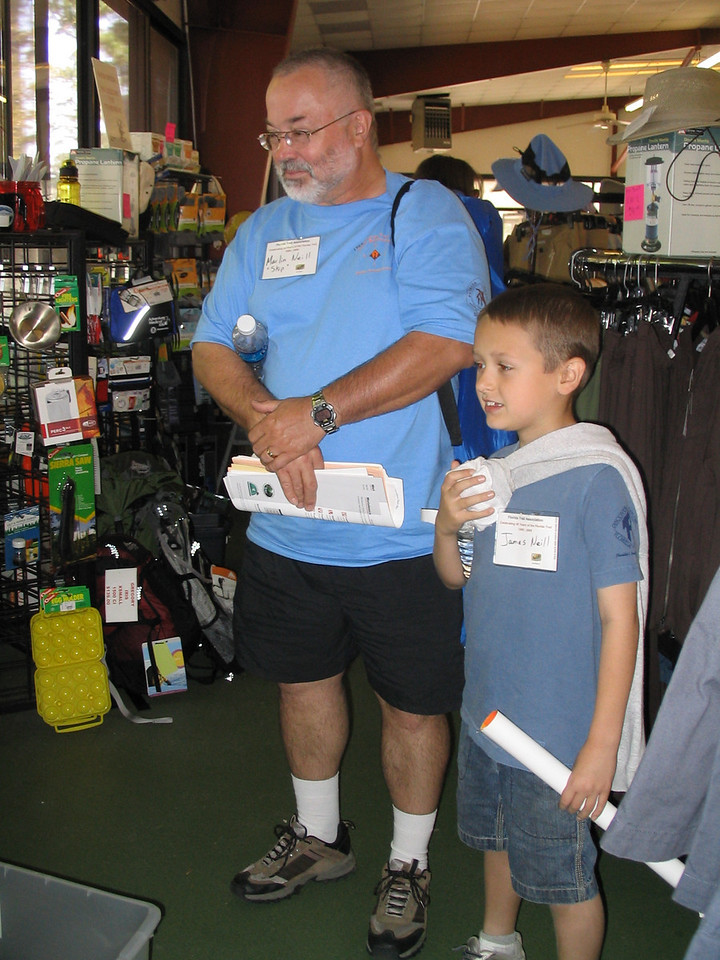 Skip O'Neill and son check out the gear store presented by Venture Out-fitters<br /> PHOTO CREDIT: Diane Wilkins / Florida Trail Association