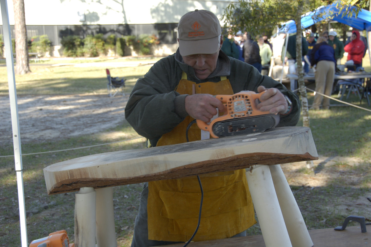 Tom Montoya works on slab benches<br /> Photo Credit: FTA / Kent Wimmer