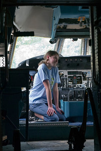 Chris Buff's daughter in the cockpit of the C-141 transport aircraft on display.