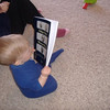 Joshua reads about great-grandpa Arrington